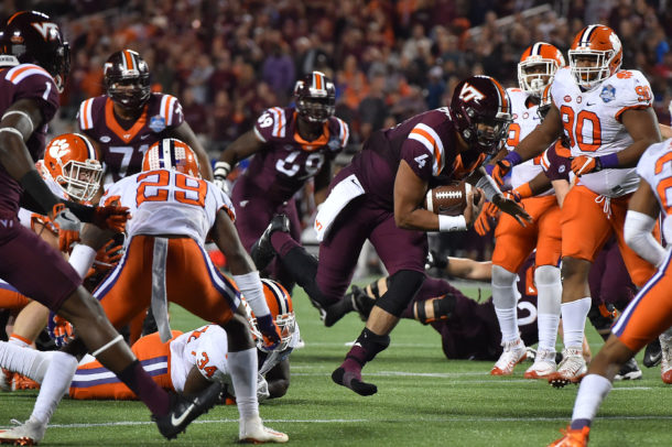 Dec 3, 2016; Orlando, FL, USA; Virginia Tech Hokies quarterback Jerod Evans (4) runs the ball for a touchdown against the Clemson Tigers during the first half of the ACC Championship college football game at Camping World Stadium. Mandatory Credit: Jasen Vinlove-USA TODAY Sports
