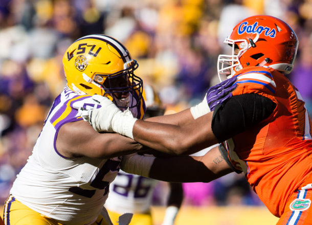 Nov 19, 2016; Baton Rouge, LA, USA; LSU Tigers defensive tackle Davon Godchaux (57) and Florida Gators offensive lineman Martez Ivey (73) in action during the game at Tiger Stadium. The Gators defeat the Tigers 16-10. Mandatory Credit: Jerome Miron-USA TODAY Sports