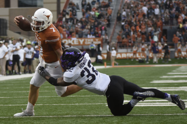 Nov 25, 2016; Austin, TX, USA; Texas Longhorns quarterback Shane Buechele (7) is tackled short of the end zone by Texas Christian Horned Frogs linebacker Travin Howard (32) during the first half at Darrell K Royal-Texas Memorial Stadium. Mandatory Credit: Brendan Maloney-USA TODAY Sports