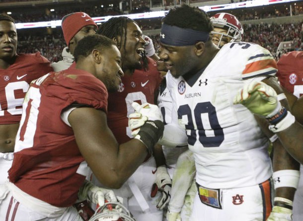 Nov 26, 2016; Tuscaloosa, AL, USA; Alabama Crimson Tide linebacker Shaun Dion Hamilton (20) after the game with Auburn Tigers running back Damian Lewis (30)at Bryant-Denny Stadium. The Tide defeats the Tigers 30-12. Mandatory Credit: Marvin Gentry-USA TODAY Sports