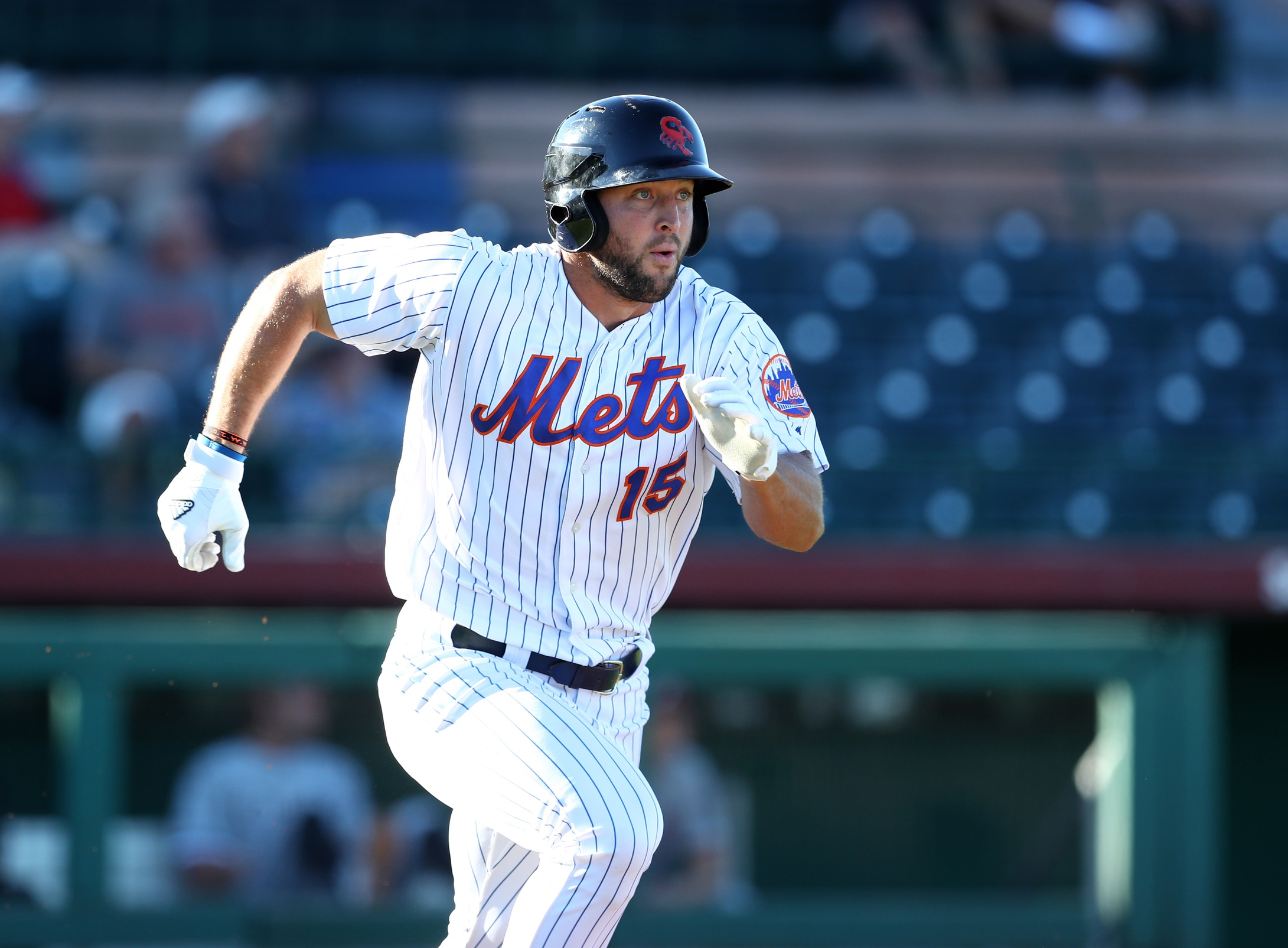 Tim Tebow makes a legitimately great jumping catch at the outfield wall