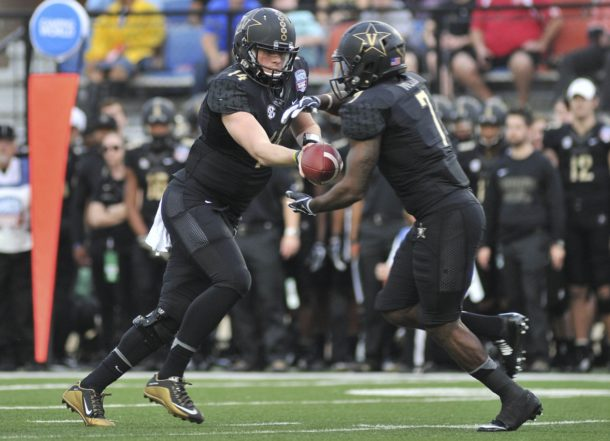 Dec 26, 2016; Shreveport, LA, USA; Vanderbilt Commodores quarterback Kyle Shurmur (14) hands the ball off to Vanderbilt Commodores running back Ralph Webb (7) during the first half against the North Carolina State Wolfpack at Independence Stadium. Mandatory Credit: Justin Ford-USA TODAY Sports