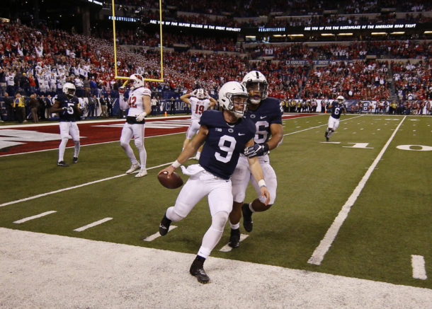 Dec 3, 2016; Indianapolis, IN, USA; Penn State Nittany Lions quarterback Trace McSorley (9) celebrates the victory with running back Saquon Barkley (26) as the game ends against the Wisconsin Badgers during the Big Ten Championship college football game at Lucas Oil Stadium. Penn State defeats Wisconsin 38-31. Mandatory Credit: Brian Spurlock-USA TODAY Sports