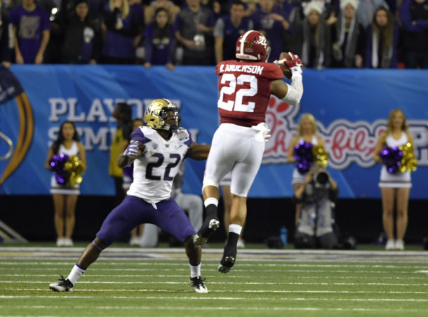 Dec 31, 2016; Atlanta, GA, USA; Alabama Crimson Tide linebacker Ryan Anderson (22) makes an interception and runs it back for a touchdown against Washington Huskies running back Lavon Coleman (22) during the second quarter in the 2016 CFP semifinal at the Peach Bowl at the Georgia Dome. Mandatory Credit: Dale Zanine-USA TODAY Sports