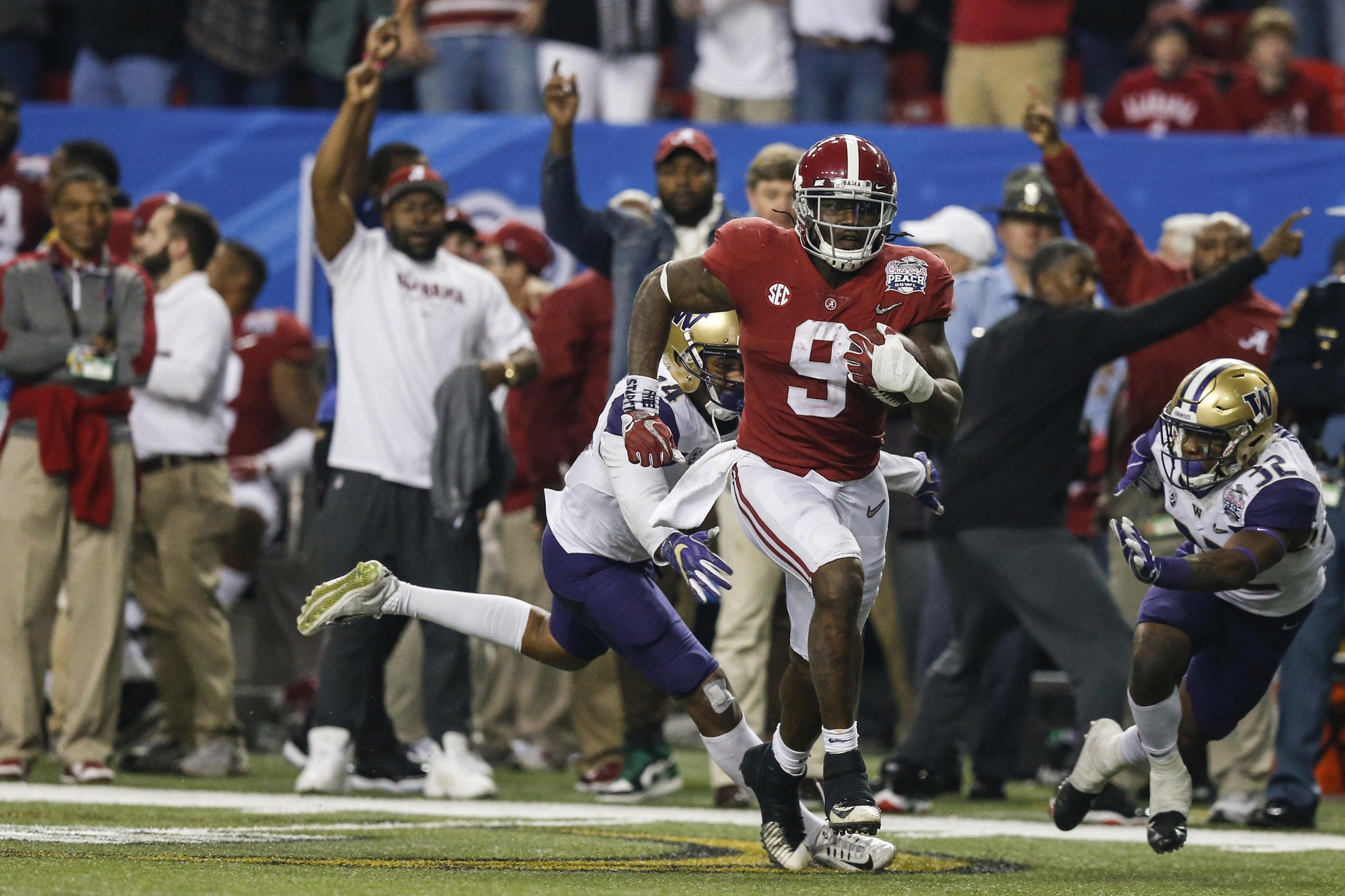 Dec 31, 2016; Atlanta, GA, USA; Alabama Crimson Tide running back Bo Scarbrough (9) runs the ball for a touchdown during the fourth quarter in the 2016 CFP Semifinal against the Washington Huskies at the Georgia Dome. Mandatory Credit: Jason Getz-USA TODAY Sports