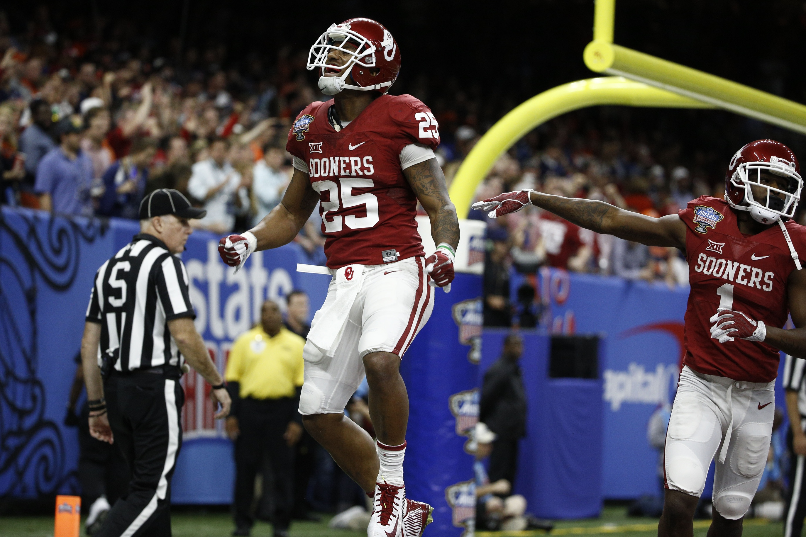 Jan 2, 2017; New Orleans , LA, USA; Oklahoma Sooners running back Joe Mixon (25) reacts with wide receiver Jarvis Baxter (1) after scoring a touchdown against the Auburn Tigers in the second quarter of the 2017 Sugar Bowl at the Mercedes-Benz Superdome. Mandatory Credit: Derick E. Hingle-USA TODAY Sports