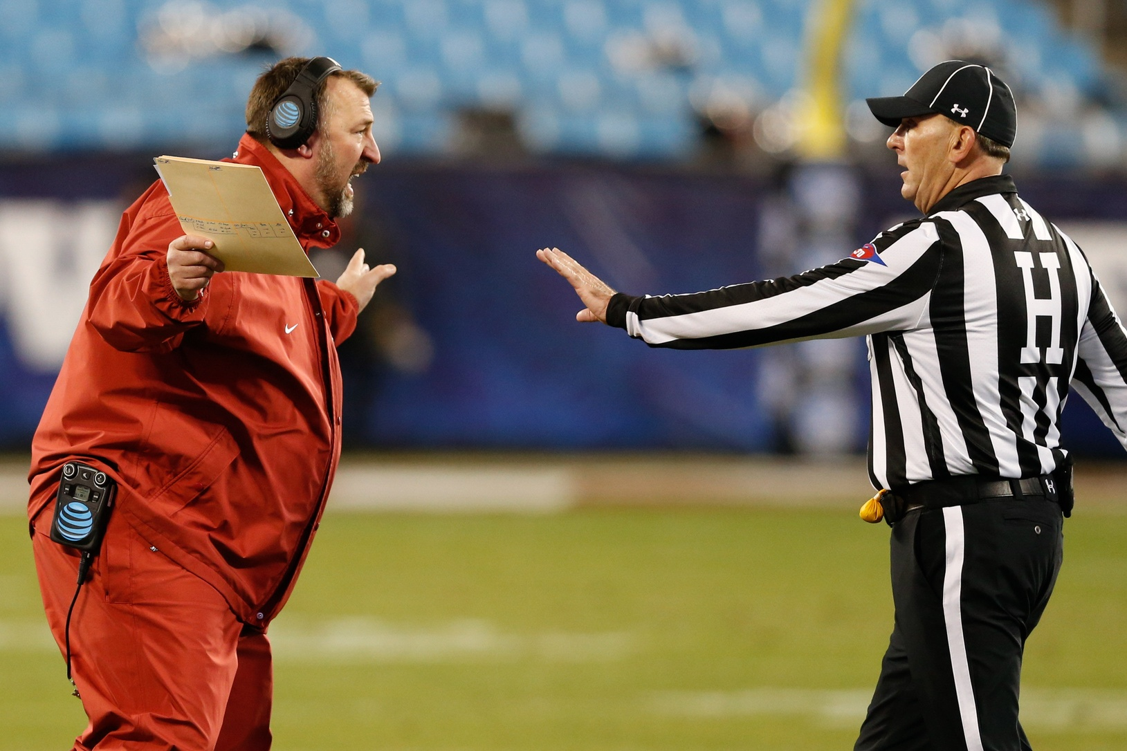 Dec 29, 2016; Charlotte, NC, USA; Arkansas Razorbacks head coach Brett Bielema argues a review in the second quarter against the Virginia Tech Hokies during the Belk Bowl at Bank of America Stadium. Mandatory Credit: Jeremy Brevard-USA TODAY Sports
