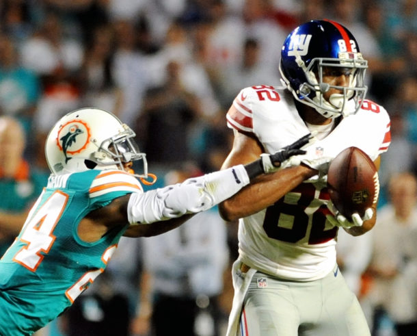Dec 14, 2015; Miami Gardens, FL, USA; Miami Dolphins cornerback Brice McCain knocks a pass away from New York Giants wide receiver Reuben Randle in the second quarter at Sun Life Stadium. Mandatory Credit: Robert Duyos-USA TODAY Sports