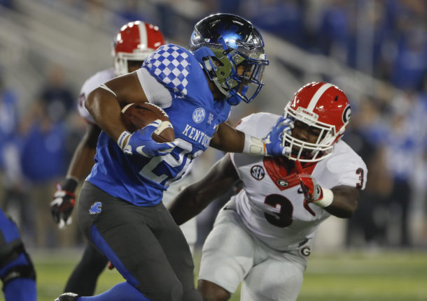 Nov 5, 2016; Lexington, KY, USA; Kentucky Wildcats running back Benny Snell (26) runs the ball against Georgia Bulldogs linebacker Roquan Smith (3) in the first quarter at Commonwealth Stadium. Mandatory Credit: Mark Zerof-USA TODAY Sports