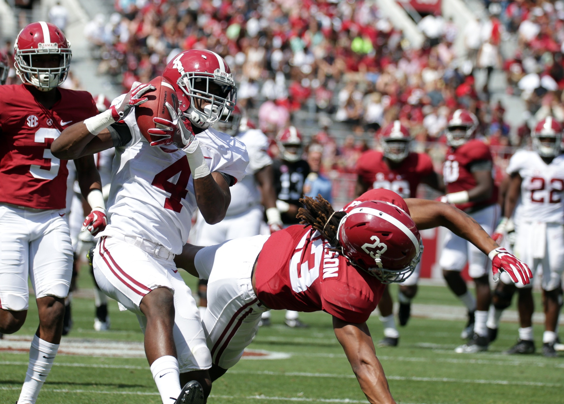 Apr 22, 2017; Tuscaloosa, AL, USA; Alabama Crimson Tide wide receiver Jerry Jeudy (4) goes up for the ball against Alabama Crimson Tide defensive back Aaron Robinson (23) for a score during the A-day game at Bryant Denny Stadium. Mandatory Credit: Marvin Gentry-USA TODAY Sports
