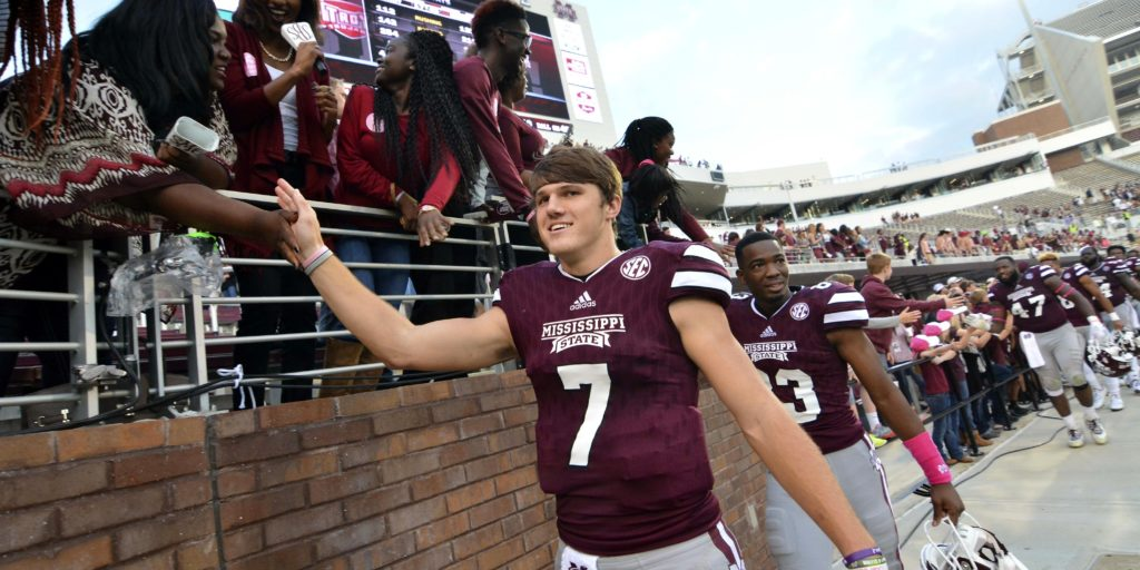Oct 10, 2015; Starkville, MS, USA; Mississippi State Bulldogs quarterback Nick Fitzgerald (7) celebrates with fans after the game against the Troy Trojans at Davis Wade Stadium. Mississippi State won 45-17. Mandatory Credit: Matt Bush-USA TODAY Sports