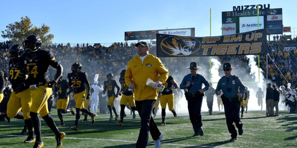 Nov 12, 2016; Columbia, MO, USA; Missouri Tigers head coach Barry Odom and starting player run out from the tunnel during player introductions before the game against the Vanderbilt Commodores at Faurot Field. Mandatory Credit: Denny Medley-USA TODAY Sports