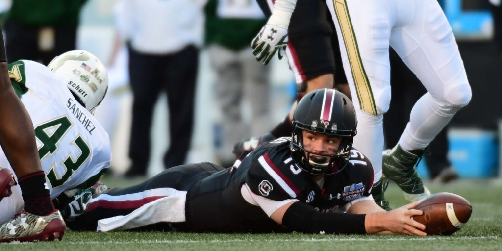 Dec 29, 2016; Birmingham, AL, USA; South Carolina Gamecocks quarterback Jake Bentley (19) holds the ball on the field after a tackle by South Florida Bulls linebacker Auggie Sanchez (43) during the third quarter in the 2016 Birmingham Bowl at Legion Field. Mandatory Credit: Shanna Lockwood-USA TODAY Sports