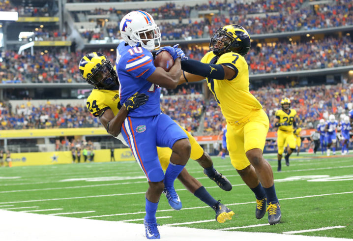 Florida's defense picks 2 for TDs, then blocks punt against MI